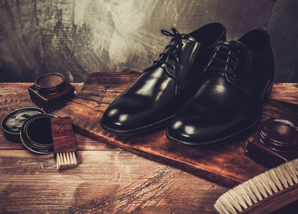 37063375 - shoe care accessories on a wooden table