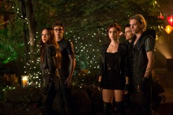 Jemina West as Isabelle Lightwood, Robert Sheehan as Simon Lewis, Lily Collins as Clary Fray, Kevin Zegers as Alec Lightwood, and Jamie Campbell Bower as Jace Wayland (Image Credit: 2013 Constantin Film International GmbH and Unique Features (TMI) Inc.)