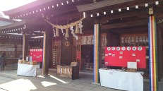 I really don't like to photograph the inside of shrines and temples. Here I made the exception because of the hinamatsuri signs. The big wooden box is for offerings and prayers.
