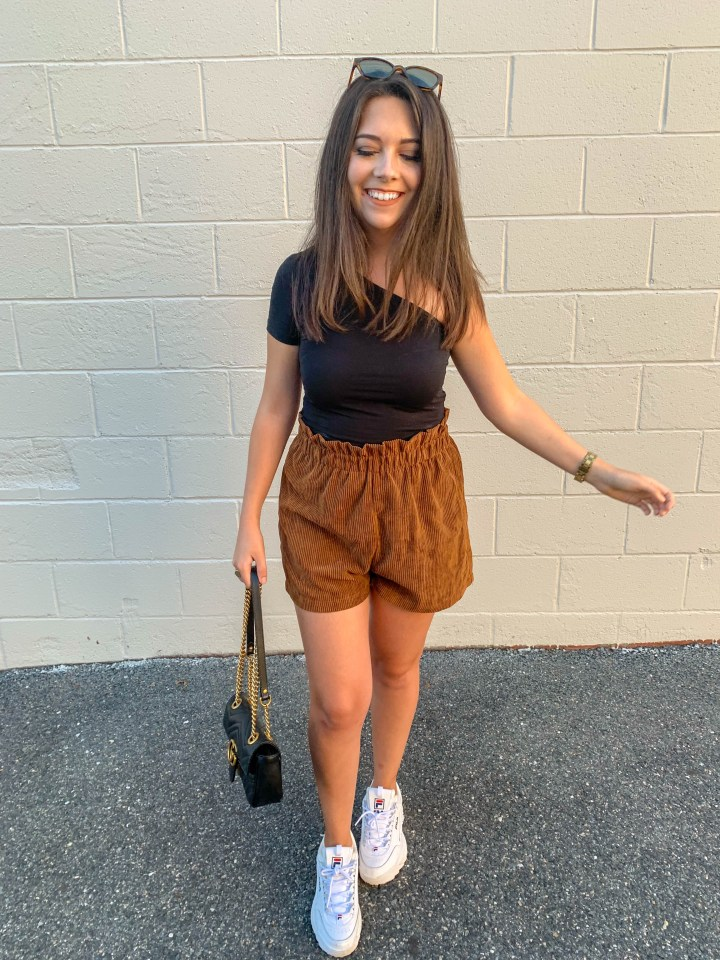 black one shoulder top and corduroy shorts 1