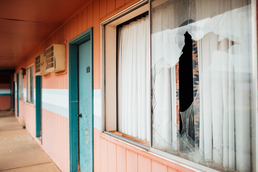 broken window at abandoned motel