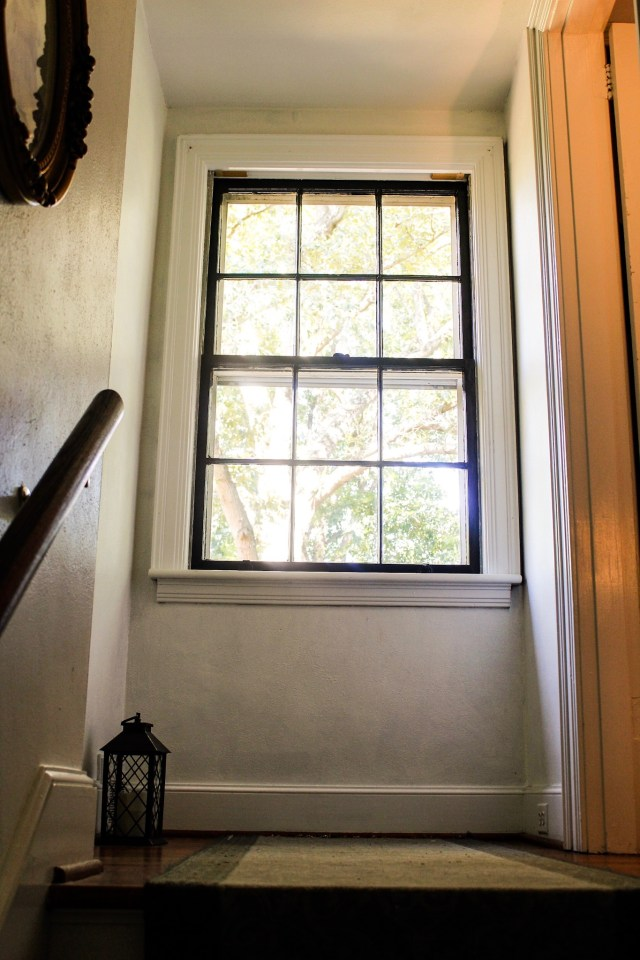 This multi-paned window in a little nook was crying out for a window seat.