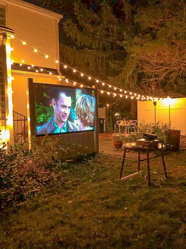Scene from You've Got Mail on backyard movie screen
