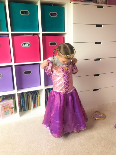 girl trying on a princess outfit