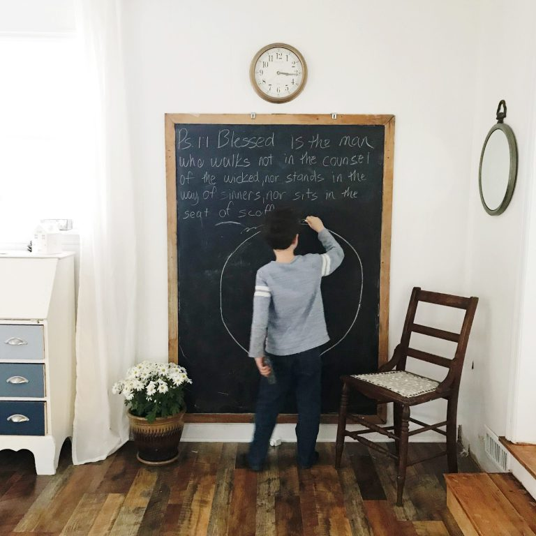 Boy drawing on chalkboard
