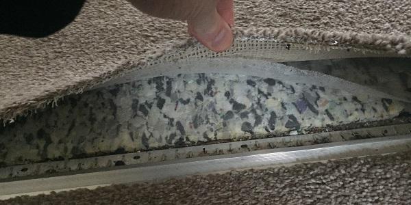 why is it wet under my carpet