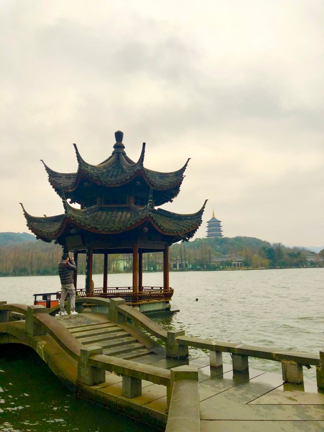 long bridge pavillion with temple in the back ground west lake Visiting friends in Hangzhou www.thedancingcircustraveller.com