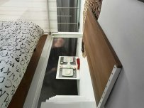 a-trapdoor-leads-up-to-the-lofted-bedroom-area
