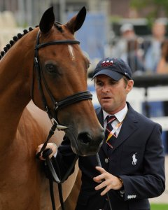 Phillip Dutton of the United States walks with Connaught during the veterinary inspection for the Eventing competition at the Beijing 2008 Olympics in Hong Kong, Friday, Aug. 8, 2008. (AP Photo/Susan Walsh)