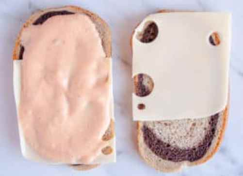 Open faced sandwich with swiss cheese and thousand island dressing