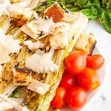 Grilled Caesar Salad with parmesan, croutons and grape tomatoes