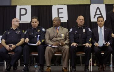 From left, Boynton Beach Police Chief Katz, Delray Police Chief Goldman, Riviera Beach Police Chief Wlliams, West Palm Beach Police Chief Kummerlen, and State Attorney Aronberg at the P.E.A.C.E. (People Engaged in Active Community Efforts) Assembly at the Palm Beach Convention Center on March 23, 2015. The group addressed local law enforcement officials on arrests of both juvenile offenders and undocumented immigrants. (Brianna Soukup / Palm Beach Post)