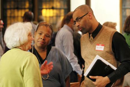 community organizer talks with community leaders