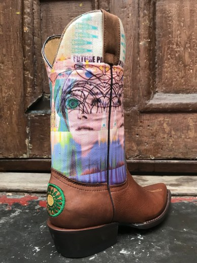 "The Theda Sandiford Artist Boot in collaboration with Planet Cowboy Boots. -13"" tall boot -J toe -1 1/2"" stacked leather heel -full leather sole -Canvas on Leather top replicating Theda Sandifords are Piece -Embroidery on foot on heel to compliment image. -handcrafted in Mexico by Planet Cowboy *Limited size run available"