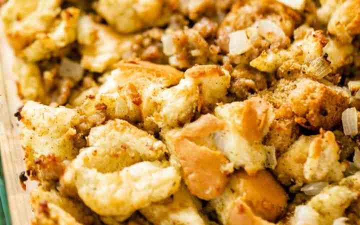 Freshly cooked sausage stuffing sits in a casserole dish ready to enjoy.