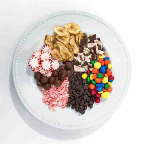 A plate of candy sits ready to be used as decorations on holiday houses.