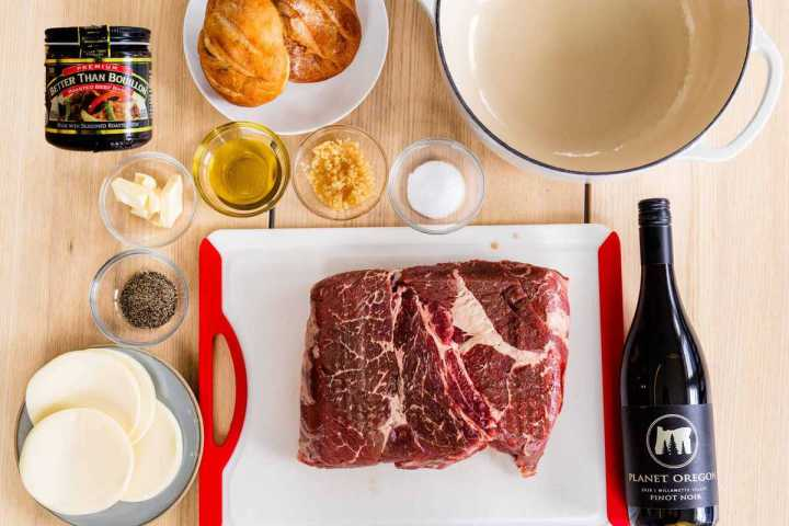 All the ingredients for French Dip sandwiches sit on the tabletop.