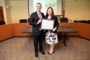 DCA Chief Deputy Director Chris Shultz with program graduate Amelia Hicks.