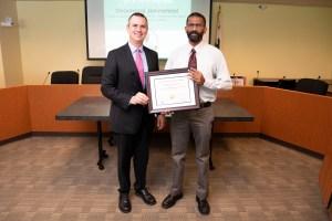 DCA Chief Deputy Director Chris Shultz (left) with program graduate Dharmaraj Jeevamani.