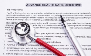 An advance care directive document is shown with a pen and stethescope.