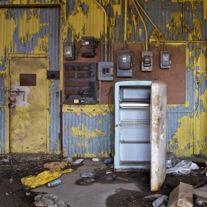 An abandoned warehouse features an old, dangerous refrigerator.
