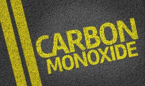 Carbon monoxide painted in yellow on a road.