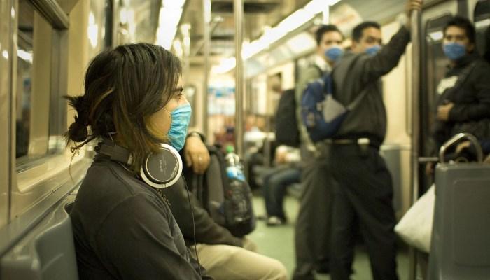 wearing flu masks on the train