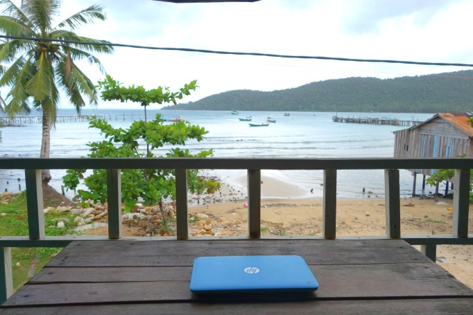 Laptop on a balcony overlooking the shores of Koh Rong Samloem