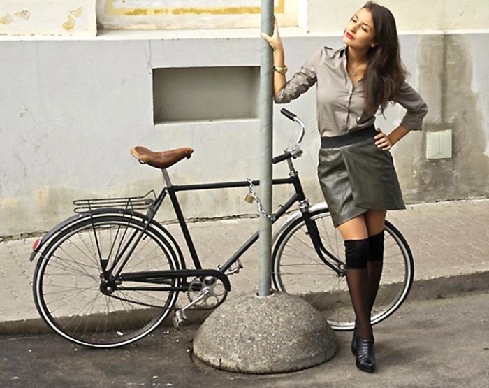 A beautiful woman and a beautiful bicycle.