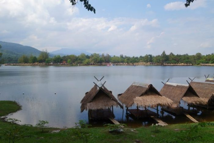 Thatched huts on the shores of the Huay Tung Tao lake..