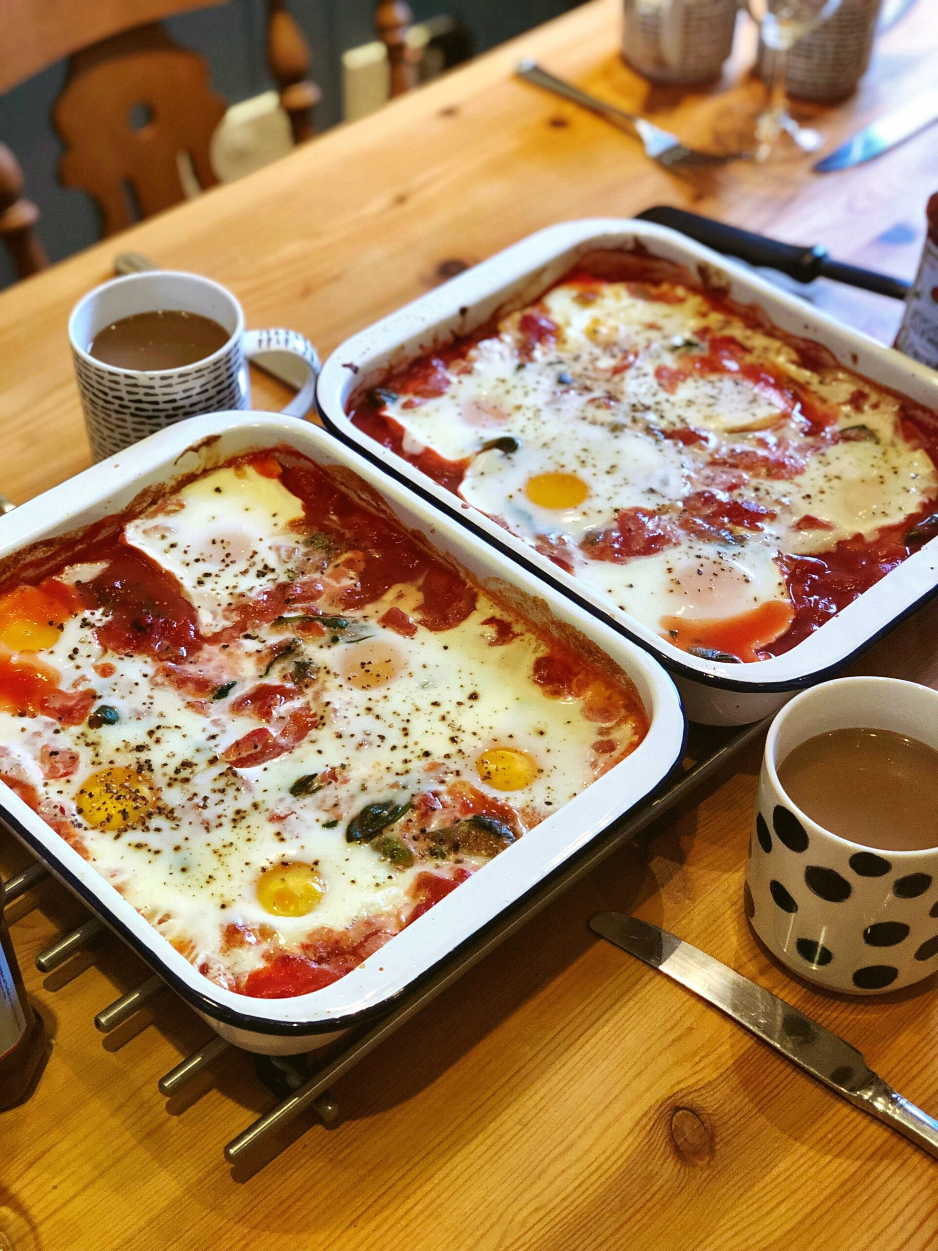 Baked eggs in spiced tomatoes