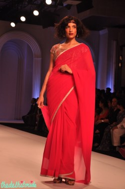 Plain sari paired with a very heavy blouse