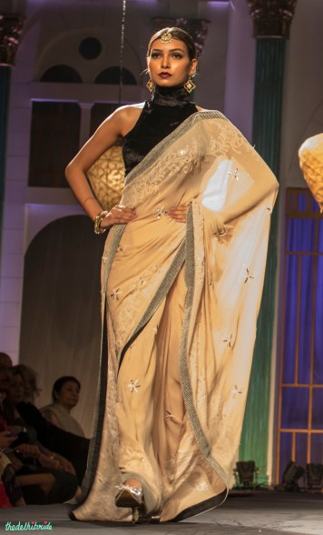 Beige sari with black halter velvet blouse
