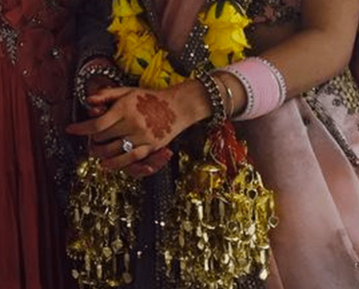 A small amount of mehendi at the back of her hands