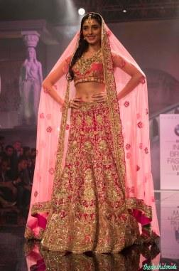 Suneet Varma - Pernia Qureshi in a Heavily Embroidered Fuschia Pink Bridal Lehenga with Gold Work - BMW India Bridal Fashion Week 2015