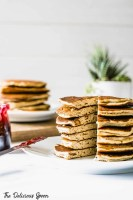 A stack of Peanut Butter Protein Pancakes on a white plates