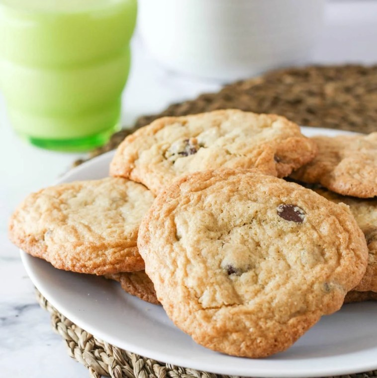 Full Plate of Chocolate Chip Cookies with a Glass of Milk