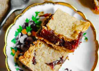 Two date squares stacked on top of a beautiful antique saucer with a stunning gold rim