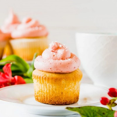 White Chocolate Vanilla Cupcakes with Strawberry Frosting