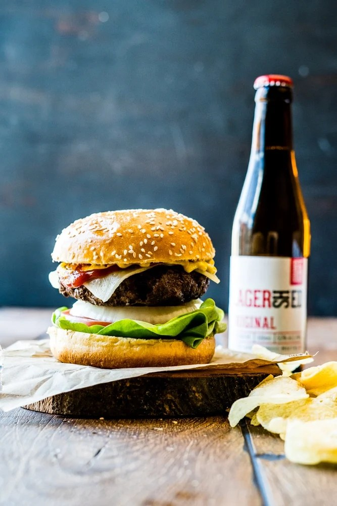 Hamburger with some beer and potato chips