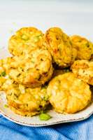 Close up of a plate filled with keto egg muffins on a white background