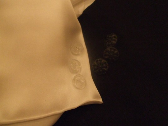 Off white silk satin, antique glass buttons and Hugo Boss linen with 'jet' buttons