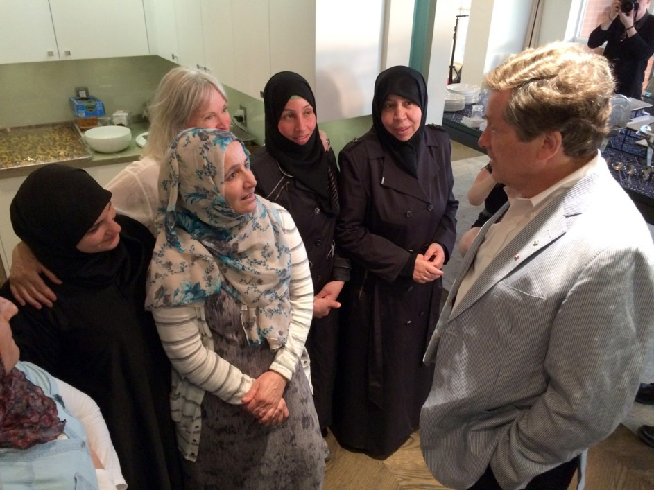 Mayor John Tory meets the Newcomer Kitchen cooks.
