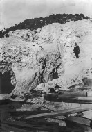 Lila C Mine - Outcrop of Colmanite ore at the mine, Mr. Smitheram, Foreman, and lower down, John Ryan, general manager 1910, Courtesy National Park Service, Death Valley National Park