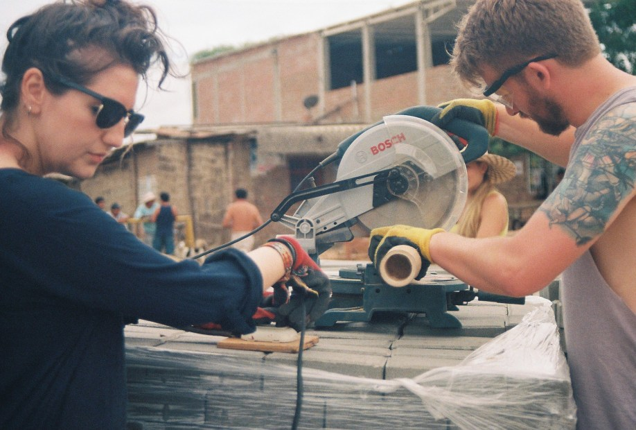 RMIT students, Jumana, and Micheal using power tools were used on-site to cut bamboo stalks quickly and efficiently.