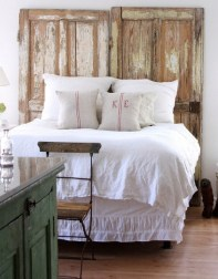 Maria Carr of Dreamy Whites used these beautiful rustic doors as headboard in her horse ranch master bedroom | via http://dreamywhites.blogspot.com/2010/08/hello-everyone-i-hope-you-are-all.html