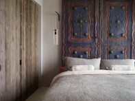A Bohemian New York apartment with gorgeous Thai Temple Doors as a headboard by Incorporated NY | via http://www.incorporatedny.com/album?id=5750972229497478945