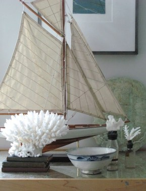 Adore this nautical-inspired vignette... that little sailboat is awesome! | via http://anurbancottage.blogspot.com/2011/11/vignettes-101.html