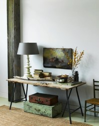 What a beautiful statement for an entryway. All this beat-up salvaged door needed to make it a gorgeous table was a pair of metal trestle legs from Ikea | via http://ysvoice.tumblr.com/post/6571286927/corner-table#.UmEkSXBRpWJ
