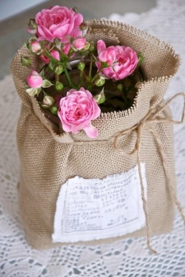 If your mum has green fingers consider rather giving her a potted plant - it will last so much longer. This little burlap bag adds a bit of character to these potted roses | via http://www.pinterest.com/pin/16466354857896365/